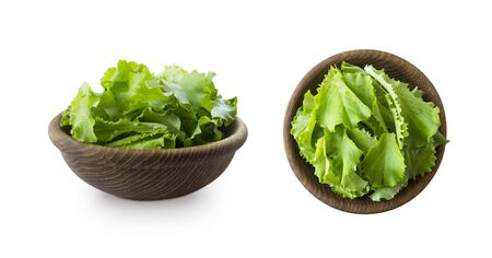 Young lettuce leaves in wooden bowl. Top view. Lettuce isolated on a white background. Green lettuce with copy space for text. lettuce leaves isolated on white. Salad from different angles on white. Imagens