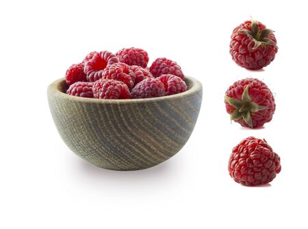 Raspberries isolated on white background. Raspberries on wooden bowl. Raspberry with copy space for text. Juicy and delicious raspberries isolation on white. Raspberries from different angles on white