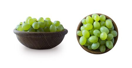 Green grapes Kishmish isolated on white. Top view. Grapes in a wooden bowl isolated on white. Green grapes Kishmish with copy space for text. Grapes from different angles isolated on white background.