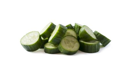 Sliced cucumber isolated on white. Cucumbers with copy space for text. Cucumbers isolated on white background. Fresh cucumber slices isolated on white background. Fresh chopped cucumber vegetables. Imagens