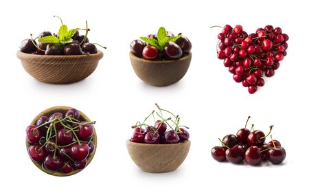 Red cherries isolated on white cutout. Berry with copy space for text. Set of cherry from different angles. Ripe cherries in the shape of a heart. Red cherries isolated on white background. Top view. Imagens