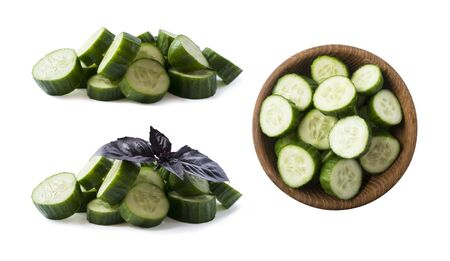 Sliced cucumber isolated on white. Cucumbers with oregano leaf with copy space for text. Ð¡ucumber slices isolated on white background. Ð¡hopped cucumber vegetables.Set of cucumber from different angles