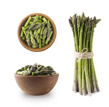 Bowl of asparagus isolated on white background. Asparagus with copy space for text on white.Edible asparagus sprouts isolated on white background.Set of edible asparagus from different angles.Top view