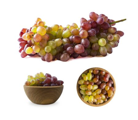 Grapes Kishmish isolated on white background. Top view. Bunch of grapes and berries in a bowl isolated on white. Pink grapes Kishmish with copy space for text.  Set of grapes from different angles.