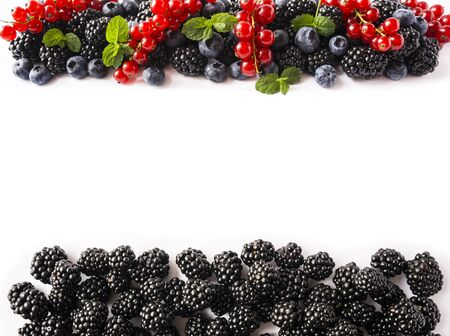 Mix fruits berries. Ripe red currant, blueberry, blackberry. Berry with copy space for text. Background of berries. Top view. Immunity system improvement. Antiviral treatment. Coronavirus prevention.