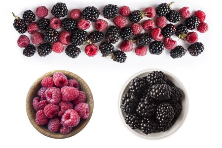 Background of blackberry and raspberry on white background. Blackberry and raspberry isolation. Top view. Black and pink berry. Immunity system improvement. Antiviral treatment. Coronavirus prevention