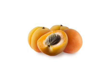 Ripe apricots isolate on a white. Apricots isolated on white background. Ripe apricots with copy space for text. Immunity system improvement. Antiviral treatment. Coronavirus prevention.