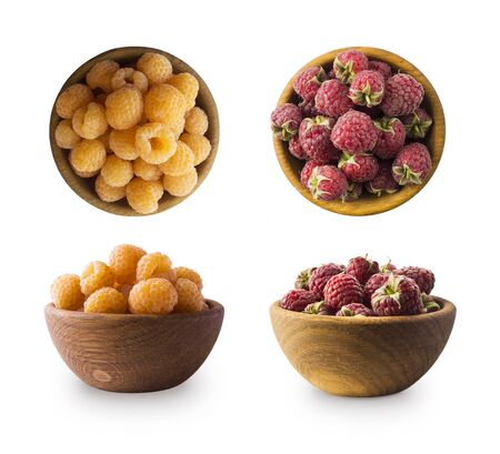Raspberries in wooden bowl. Yellow and red raspberries isolated on white. Delicious raspberry with copy space for text. Top view. Immunity system improvement.Antiviral treatment.Coronavirus prevention