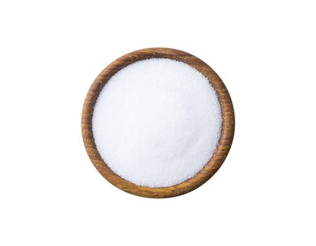 Heap of erythritol isolated on white background. Top view. Sugar substitute on white background. Wooden bowl of erythritis isolated on white background. Sweetener in wooden bowl for cooking, isolated.