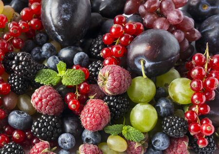 Background of fresh fruits and berries. Mix berries and fruits. Top view. Background berries and fruits. Imagens