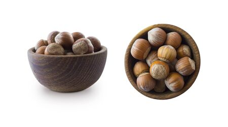Studio shot of hazelnuts on white background. Heap of hazelnut in nutshell isolated on white. Nuts in a bowl with copy space for text. Hazelnut close-up. hazelnut