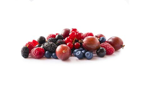 Fruits, berries isolated on white background. Fruits and berries with copy space for text. Currant, blueberry, gooseberry, mulberry, raspberry. Mixed berries isolated on white background.Berries close-up