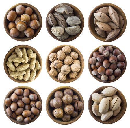 Set of nuts isolated on white background. Superfood with copy space for text. Brazil nut, peanuts, hazelnuts, macadamia, walnuts, pecans. Top view. Nuts collection on a white background