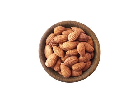 Studio shot of almonds on white background. Heap of almond isolated on white. Nuts in a bowl with copy space for text. Almonds close-up. Top view. Almonds isolation.