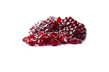 Pomegranate isolated on white background. Sweet and juicy garnet with copy space for text. Garnets isolated on white. Slices of garnets isolated on white background. Imagens