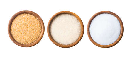 Heap of cane sugar, white sugar and erythritol isolated on white  Top view. Sugar substitute and natural sugar on white background. Wooden bowl of sweetener isolated on white. Selective focus. Imagens