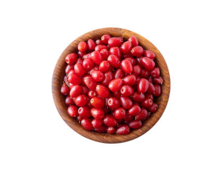 Elaeagnus multiflora (Goumi, Gumi, Natsugumi, or Cherry silverberry), is a species of Elaeagnus native to China, Korea, and Japan. Heap of gumi berries in a wooden bowl. Cherry silverberry isolated.