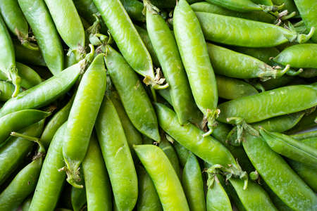 Fresh green pea background. Imagens