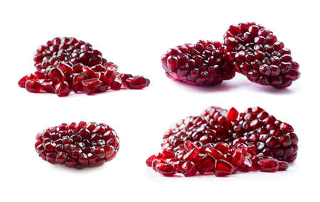 Pomegranate isolated on white background. Sweet and juicy garnet with copy space for text. Garnets isolated on white. Set of pomegranate seed from different angles on white. Pomegranate isolation.