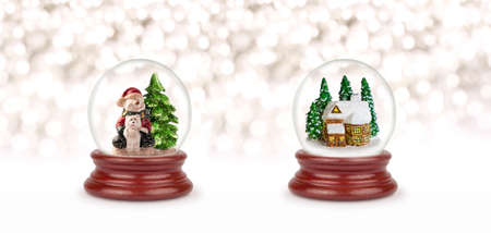 Christmas snow ball or glass globe isolated on white. Can be used as a Christmas or a New Year gift or symbol. Christmas and New Year design element. Toy glass snow globe with snowman, bear and house