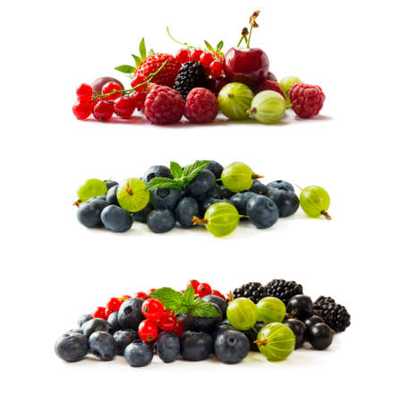 Fruits, berries isolated on white background. Fruits and berries with copy space for text. Currant, blueberry, strawberry, cherry, gooseberry, mulberry, raspberry, blackberry. Mixed berries isolated on white.