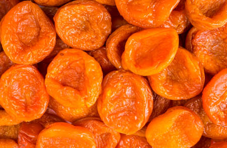 Background of dried apricots. Dried fruits of close up. Top view. Background of dried fruits. Dried apricots from Tajikistan. Dried fruit in the sun. Stock fotó