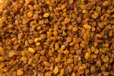 Background of raisins. Dried fruits of close up. Top view. Background raisins Kishmish. Dried fruit in the sun. Stock fotó