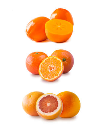 grapefruits, tangerines and persimmons isolated. Orange color fruit with copy space for text. fruits from the autumn blues, isolated. Immunity system improvement. Antiviral treatment. Virus prevention