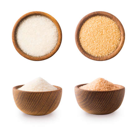 Heap of cane sugar and white sugar isolated on white background. Top view. Brown and white sugar isolation in different angles. Wooden bowl of dark sugar isolated on white background. Selective focus. Stok Fotoğraf