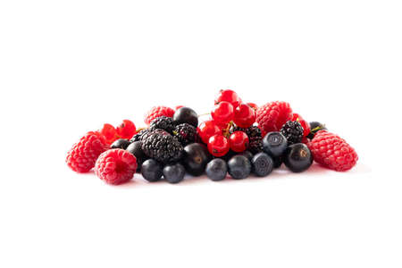 Ripe berries and fruits isolated on white background. Juicy and delicious raspberries, currants, mulberries, blackberries, blueberries. Mixed berries with copy space for text. Various fresh summer. Stok Fotoğraf