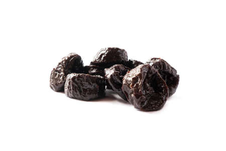 Dried prunes isolated on a white background. Dried prunes on white. Dried prunes with copy space for text.