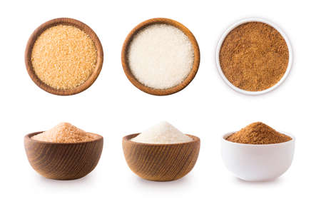 Heap of cane sugar, white and coconut sugar isolated on white Top view. Brown and white sugar isolation in different angles. Natural sugar on wooden bowl isolated on white. Selective focus. Stok Fotoğraf