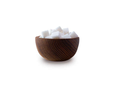 Sugar cube isolated on white. Selective focus. Sugar cube in wooden bowl on white background. Heap of sugar with copy space for text.