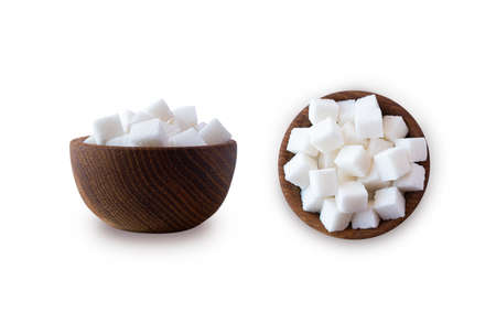 Sugar cube isolated on white. Selective focus. Sugar cube in wooden bowl on white background. Heap of sugar with copy space for text. Top view.