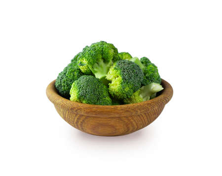 Broccoli in wooden bowl. Broccoli isolated on white. Broccoli with copy space for text. Broccoli on white background.
