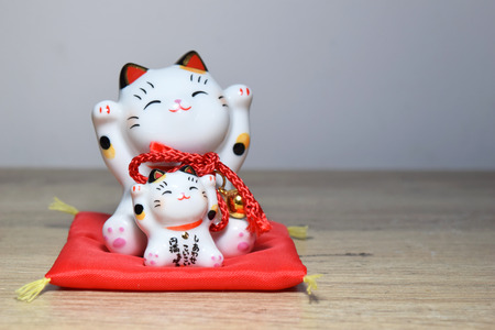 maneki: Maneki-neko is a common Japanese figurine (beckoning cat) Stock Photo