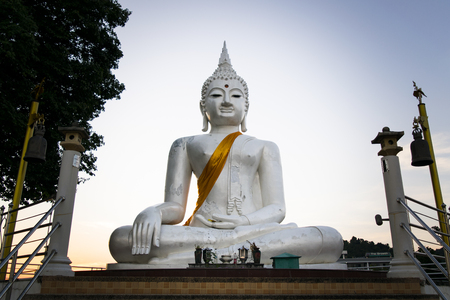 The White buddha status on blue sky background in Thailand