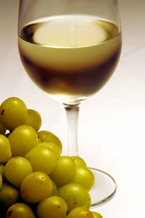 selected: A glass of white wine with grapes Stock Photo