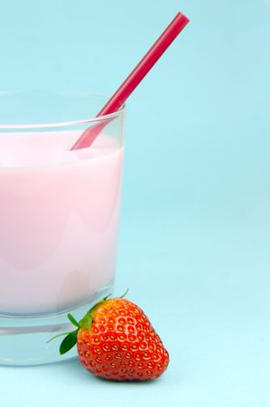 flavoured: A strawberry flavoured glass of milk isolated against a blue background