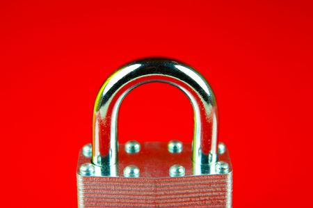 padlocked: A padlock isolated against a red background