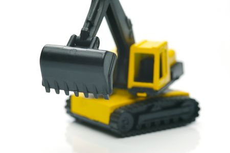 earth moving: Miniature model earth moving equipment isolated against a white background Stock Photo