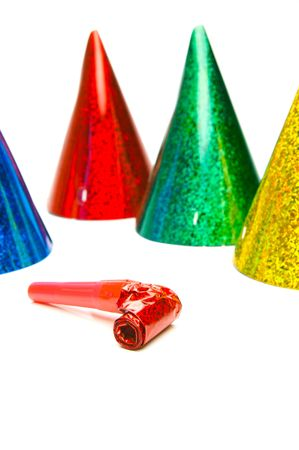 Party hats and blowers isolated against a white background photo