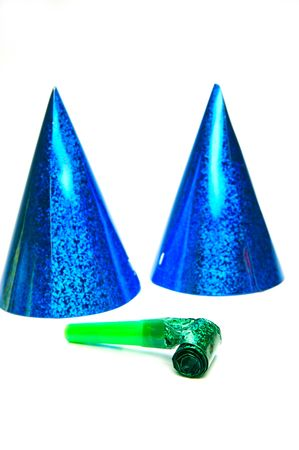 blowers: Party hats and blowers isolated against a white background