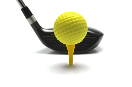 tee: Golf ball and a  golf club isolated against a white background