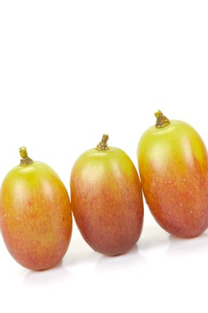 seedless: Seedless grapes isolated against a white background Stock Photo