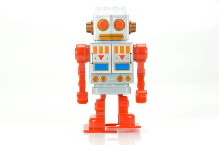 A toy robot isolated against a white background