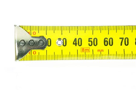 A measuring tape isolated against a white background photo