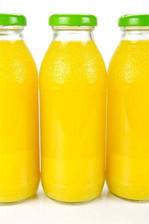 Bottles of orange juice isolated against a white background