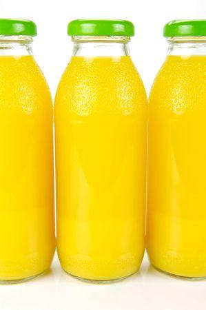 Bottles of orange juice isolated against a white background