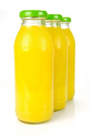 oj: Bottles of orange juice isolated against a white background